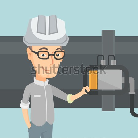 Operator checking the detector on the pipeline. Stock photo © RAStudio