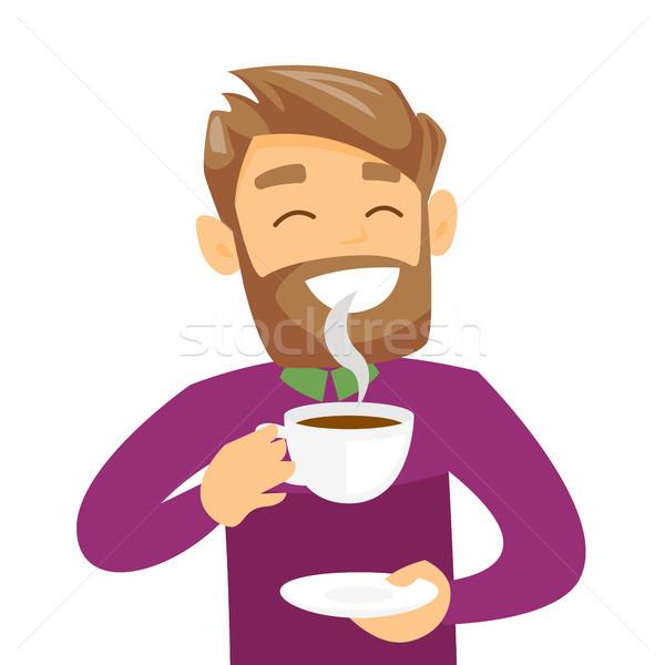 Young caucasian white man enjoying cup of coffee. Stock photo © RAStudio