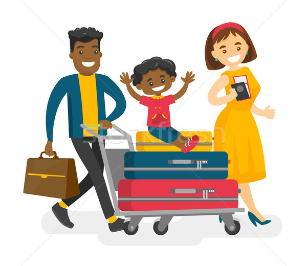 Cheerful multicultural family traveling abroad. Stock photo © RAStudio