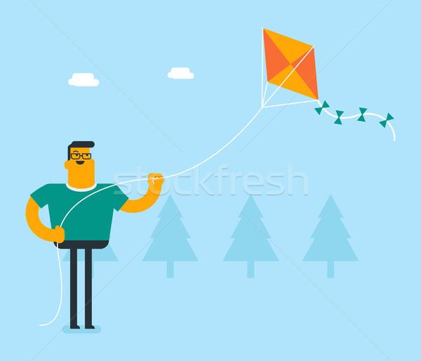 Young caucasian white person flying a kite. Stock photo © RAStudio