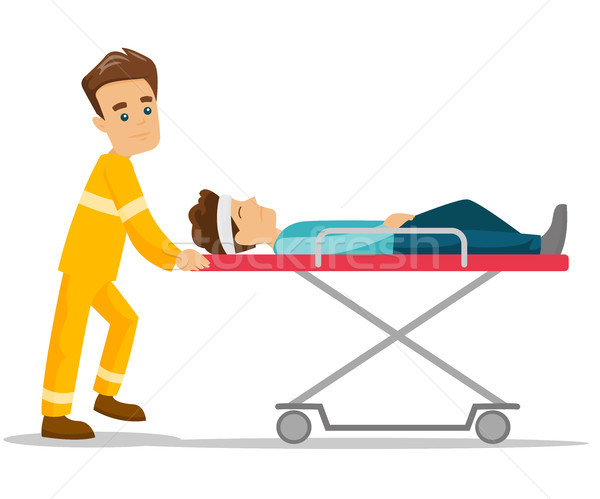 Emergency doctor transporting man on stretcher. Stock photo © RAStudio