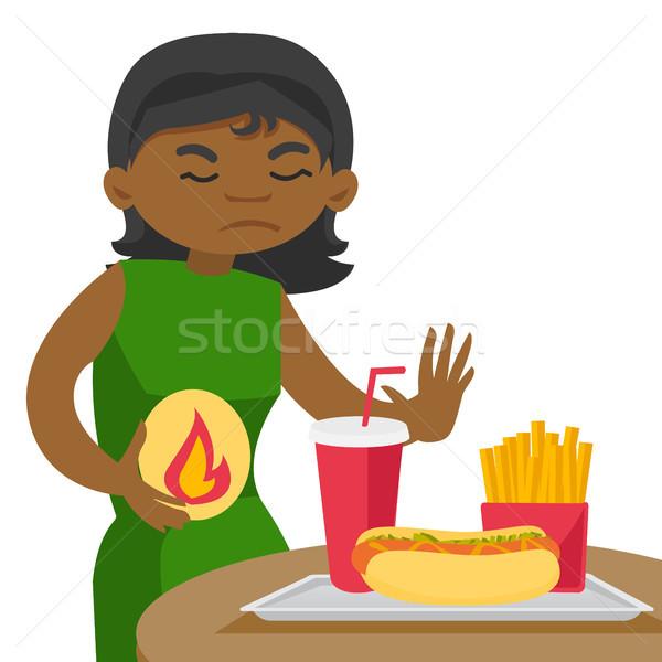 Triest afrikaanse vrouw lijden maagzuur jonge Stockfoto © RAStudio