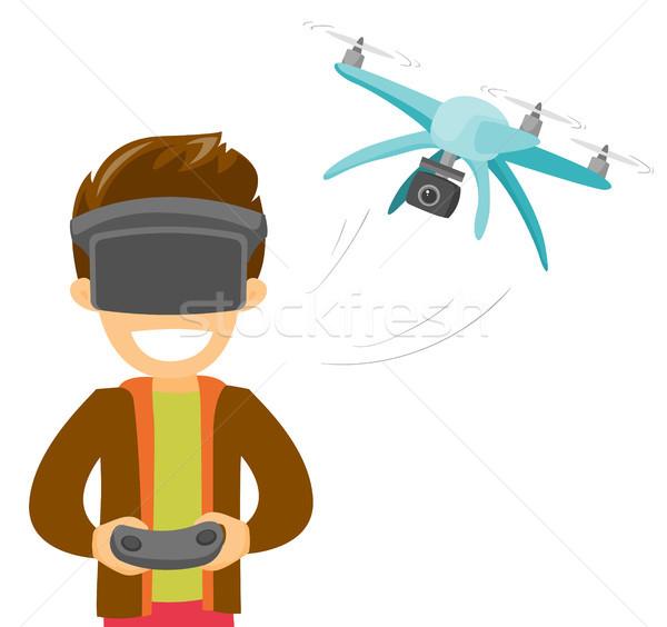 A man in virtual reality hradset controlling a drone Stock photo © RAStudio