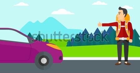 Young man hitchhiking. Stock photo © RAStudio