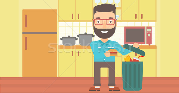 Man throwing junk food. Stock photo © RAStudio