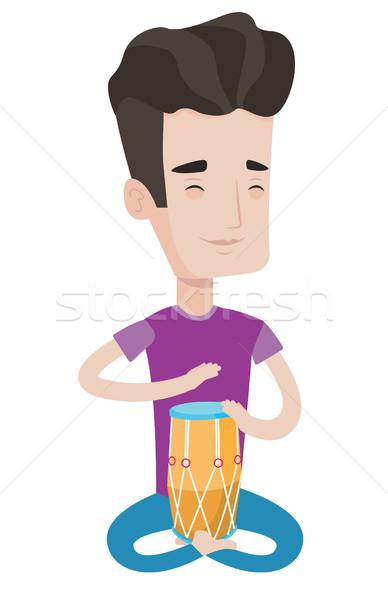Férfi játszik kisebbségi dob fiatal elégedett Stock fotó © RAStudio