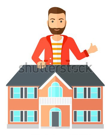 Real estate agent giving key to new house owner. Stock photo © RAStudio