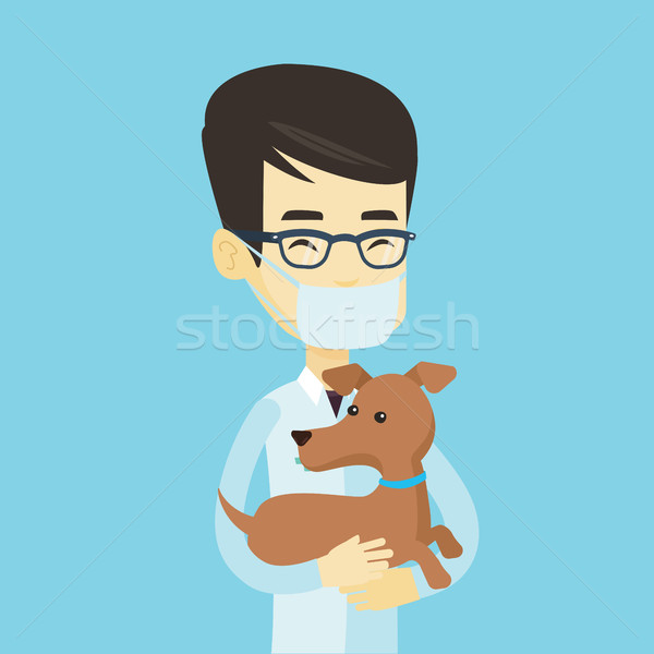ветеринар собака рук молодые азиатских врач Сток-фото © RAStudio