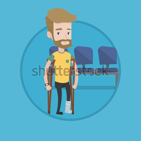 Hombre fractura en la pierna muletas herido pierna yeso Foto stock © RAStudio