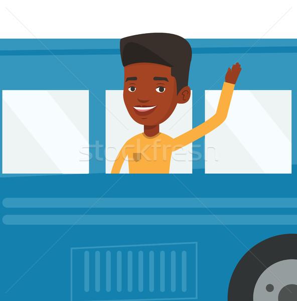 Man waving hand from bus window. Stock photo © RAStudio