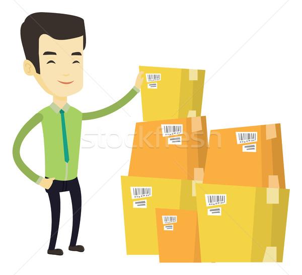 Business man checking boxes in warehouse. Stock photo © RAStudio