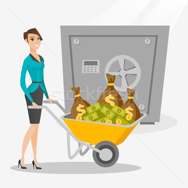 Zakenvrouw geld bank veilig kaukasisch voortvarend Stockfoto © RAStudio
