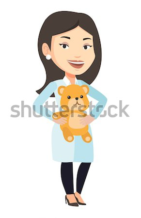 Pediatrician doctor holding teddy bear. Stock photo © RAStudio