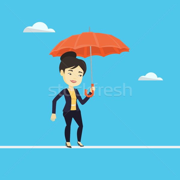 Business woman balancing on a tightrope. Stock photo © RAStudio