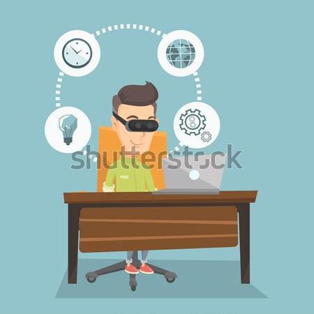 Business woman in vr headset working on computer. Stock photo © RAStudio