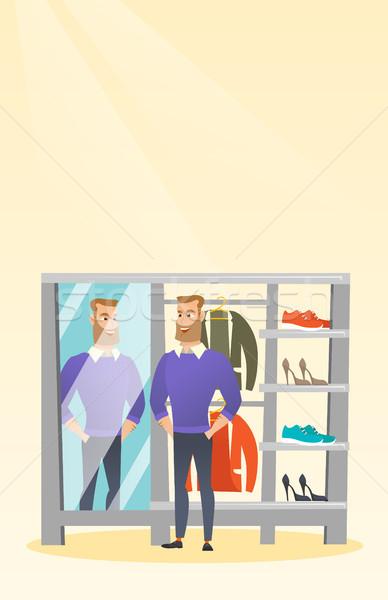 Caucásico hombre suéter vestidor jóvenes mirando Foto stock © RAStudio