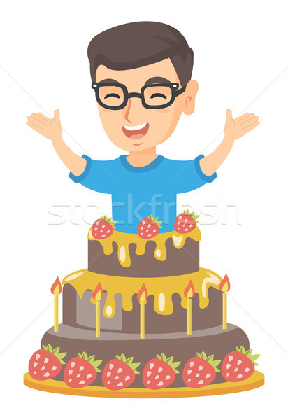 Stock photo: Little caucasian boy jumping out of a large cake.