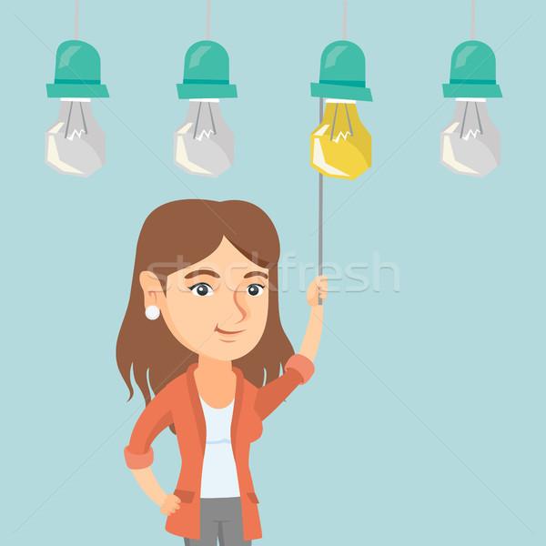 Femme d'affaires suspendu idée ampoule ampoule Photo stock © RAStudio