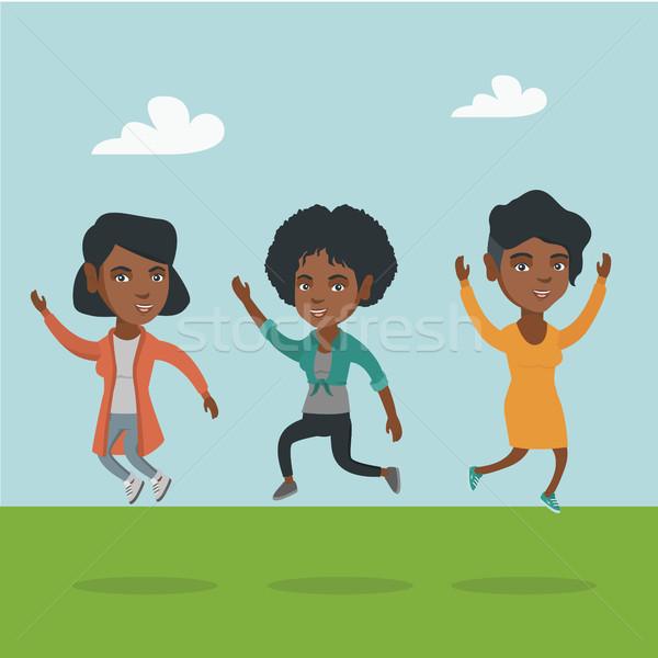 Group of joyful african-american people jumping. Stock photo © RAStudio