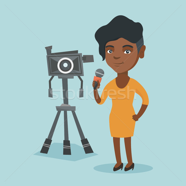 African TV reporter with microphone and camera. Stock photo © RAStudio