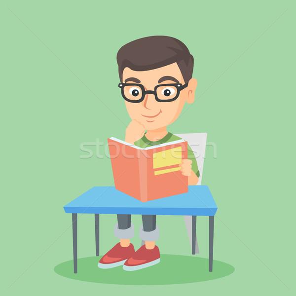 студент сидят таблице чтение книга молодые Сток-фото © RAStudio