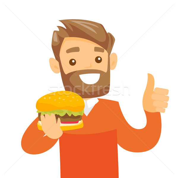 Young caucasian white man eating hamburger. Stock photo © RAStudio