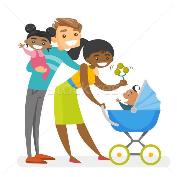 Happy diverse multiracial family with mulatto kids. Stock photo © RAStudio