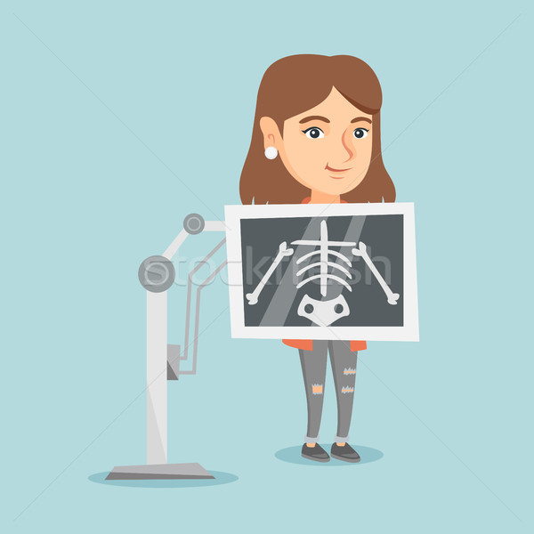 Young caucasian woman during x ray procedure. Stock photo © RAStudio