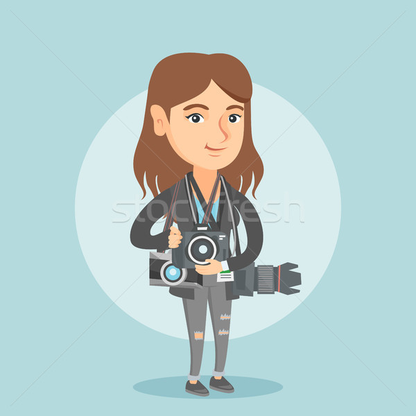 Young caucasian photographer with photo cameras. Stock photo © RAStudio