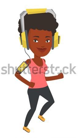 Woman running with earphones and smartphone. Stock photo © RAStudio