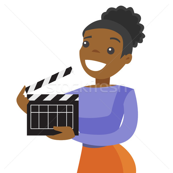 Young african woman holding a movie clapper board. Stock photo © RAStudio