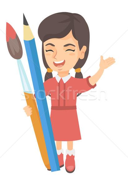 Gülen kız büyük kalem boya fırçası Stok fotoğraf © RAStudio