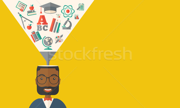 Black man with icons. Student ideas Stock photo © RAStudio
