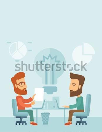 Two japanese businessmen sitting working together. Stock photo © RAStudio