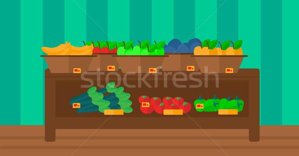 Background of vegetables and fruits on shelves in supermarket. Stock photo © RAStudio