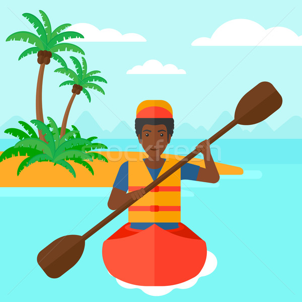 Homem equitação canoa mar pequeno ilha Foto stock © RAStudio