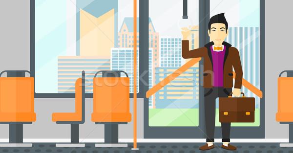 Adam ayakta içinde toplu taşıma Asya bavul Stok fotoğraf © RAStudio