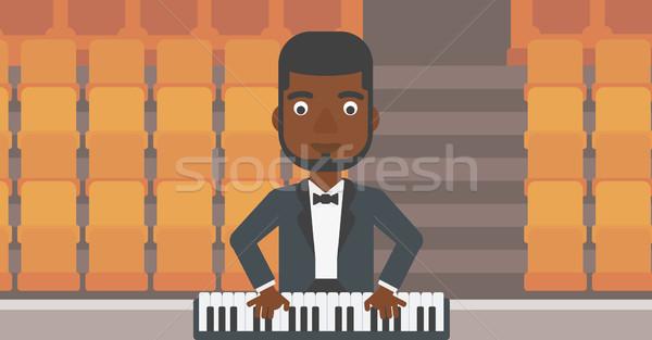Musician playing piano. Stock photo © RAStudio