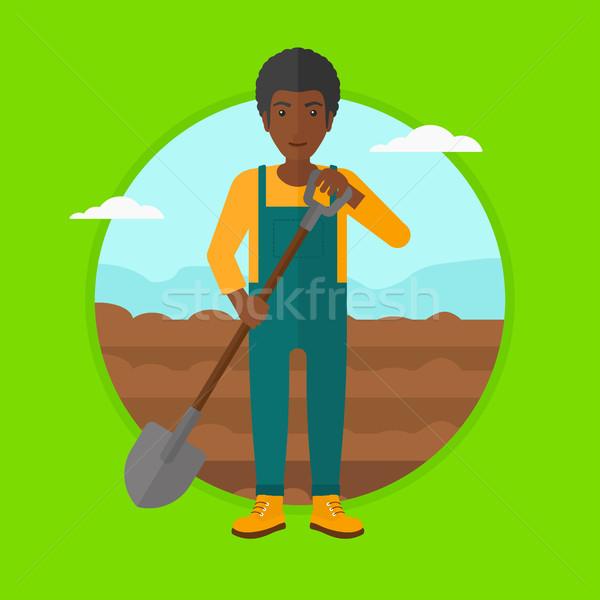 Jeans campo pá homem trabalhando em pé Foto stock © RAStudio