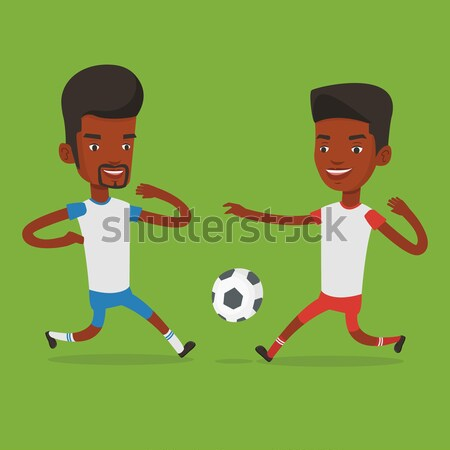 Two male soccer players fighting for ball. Stock photo © RAStudio