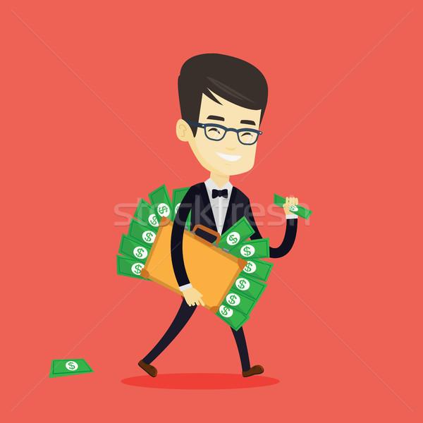 Business man with briefcase full of money. Stock photo © RAStudio