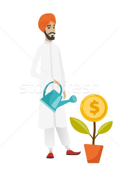 Hindu businessman watering money flower. Stock photo © RAStudio