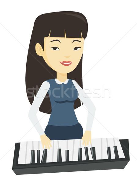 Nő játszik zongora ázsiai női zongorista Stock fotó © RAStudio