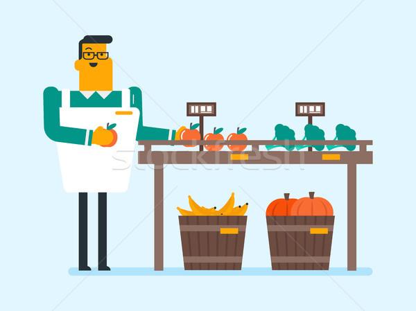 Young caucasian white worker of grocery store. Stock photo © RAStudio