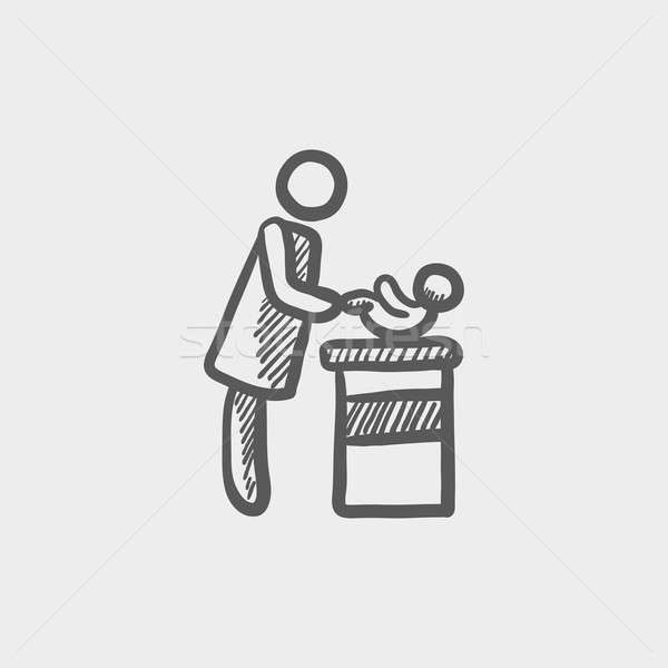 Woman changing the babys diaper sketch icon Stock photo © RAStudio