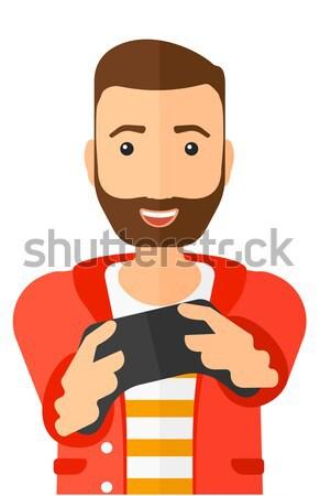 Foto stock: Hombre · jugando · videojuegos · entusiasta · gamepad · manos