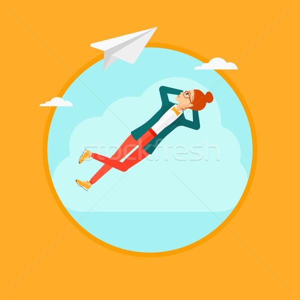Business woman lying on cloud. Stock photo © RAStudio