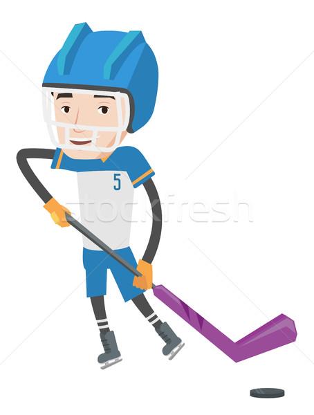 Hokej gracz młodych skating lodu Zdjęcia stock © RAStudio
