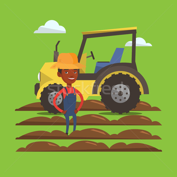 Farmer standing with tractor on background. Stock photo © RAStudio