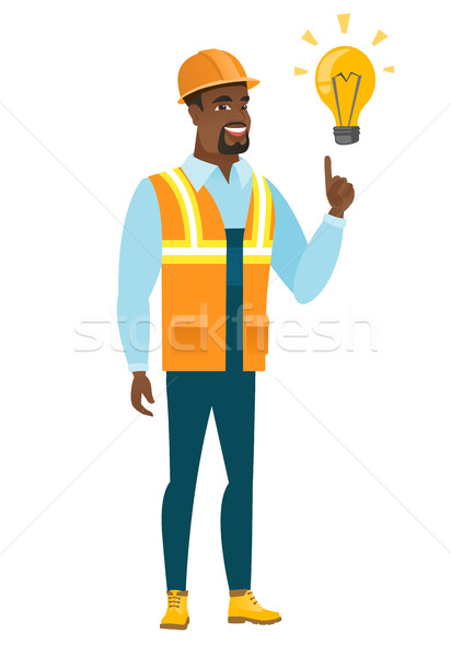 Stock photo: Builder pointing at bright idea light bulb.